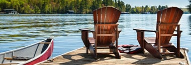 chairs at end of dock on lake